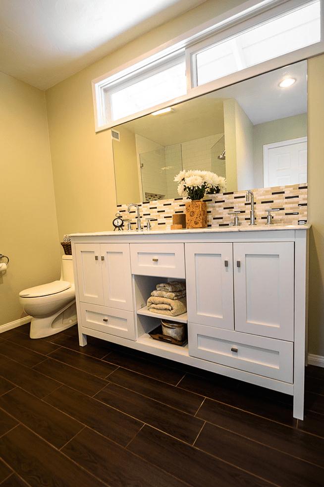 white double sink vanity next to toilet